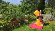 Mishel pops balloons outside in bikini 6