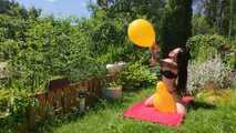 Mishel pops balloons outside in bikini 8